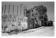 A former school in the Aida refugee camp with graffiti reminding us about the Palestinian refugee situation. Bethlehem, Palestine, 2007