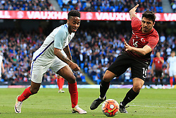 England's Raheem Sterling takes on Ozan Tufan of Turkey - Mandatory byline: Matt McNulty/JMP - 07966386802 - 22/05/2016 - FOOTBALL - Etihad Stadium -Manchester,England - England v Turkey - International Friendly