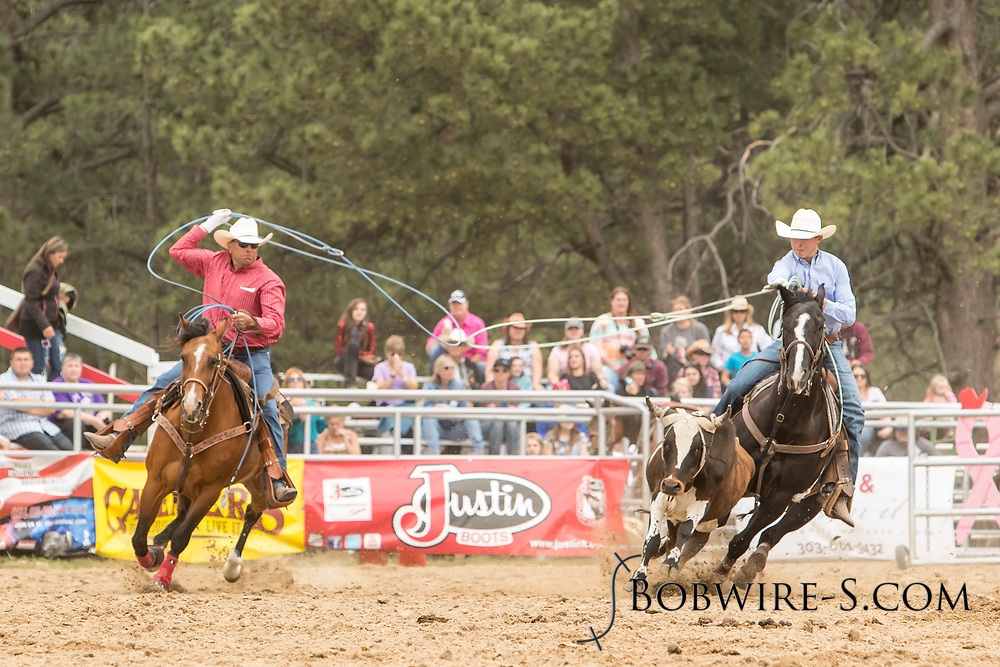 Header Levi Walter and heeler Dennis Walter make their team roping run during the third performance of the Elizabeth Stampede on Sunday, June 3, 2018.