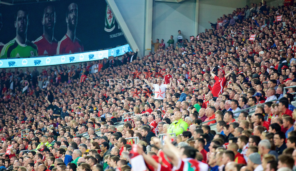 CARDIFF, WALES - Friday, June 12, 2015: Wales supporters during the UEFA Euro 2016 Qualifying Round Group B match against Belgium at the Cardiff City Stadium. (Pic by Mark Hawkins/Propaganda)