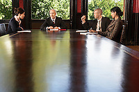 Businesspeople meeting around boardroom table