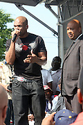 l to r: DMC and Rev.Run at 205th and Hollis for the official renaming of 205th Street to RUN-DMC JJ Way in Hollis Queens, NY on August 30, 2009..A project of Councilman Leroy Comrie, 205th street in Hollis, Queens was named after the famed Icon Rap Group, RUN-DMC, with special comments made by various community and civic leaders. This renaming marks the first time in the country that a street  is named after a Hiphop Group.