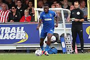 AFC Wimbledon defender Deji Oshilaja (4) dribbling during the EFL Sky Bet League 1 match between AFC Wimbledon and Sunderland at the Cherry Red Records Stadium, Kingston, England on 25 August 2018.