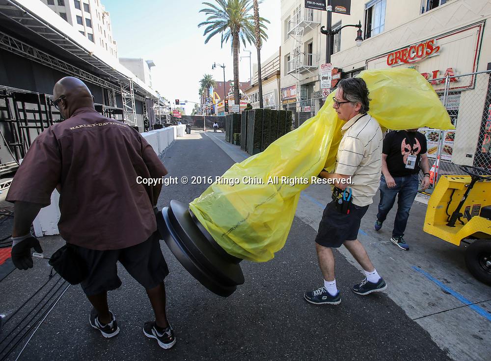Workers carry an Oscar statue to the red carpet arrivals area in front of the Dolby Theatre Feb. 25, 2016 in Los Angeles. The 88th Academy Awards will be held Sunday, February 28, 2016. (Photo by Ringo Chiu/PHOTOFORMULA.com)<br /> <br /> Usage Notes: This content is intended for editorial use only. For other uses, additional clearances may be required.