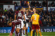 Motherwell FC Goalkeeper Connor Ripley yellow carded for challenge during the Ladbrokes Scottish Premiership match between Heart of Midlothian and Motherwell at Tynecastle Stadium, Gorgie, Scotland on 16 January 2016. Photo by Craig McAllister.