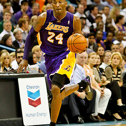 Dec 5, 2012; New Orleans, LA, USA; Los Angeles Lakers shooting guard Kobe Bryant (24) drives down court against the New Orleans Hornets during the second half of a game at the New Orleans Arena. The Lakers defeated the Hornets 103-87.  Mandatory Credit: Derick E. Hingle-USA TODAY Sports