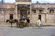 Horse and wagon delivering gravel in Moron, Ciego de Avila, Cuba.