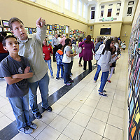 Adam Robison | BUY AT PHOTOS.DJOURNAL.COM<br /> Xander Hooper, a student at Milam, looks over the art work that is dad BJ points out to him as they visit the Tupelo Public School District's Art Show Thursday afternoon at the Gumtree Museum of Art in Tupelo.