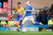 Mansfield Town midfielder Will Atkinson (11) and Chesterfield defender Andy Kellett (24)  during the EFL Sky Bet League 2 match between Chesterfield and Mansfield Town at the Proact stadium, Chesterfield, England on 14 A pril 2018. Picture by Nigel Cole.