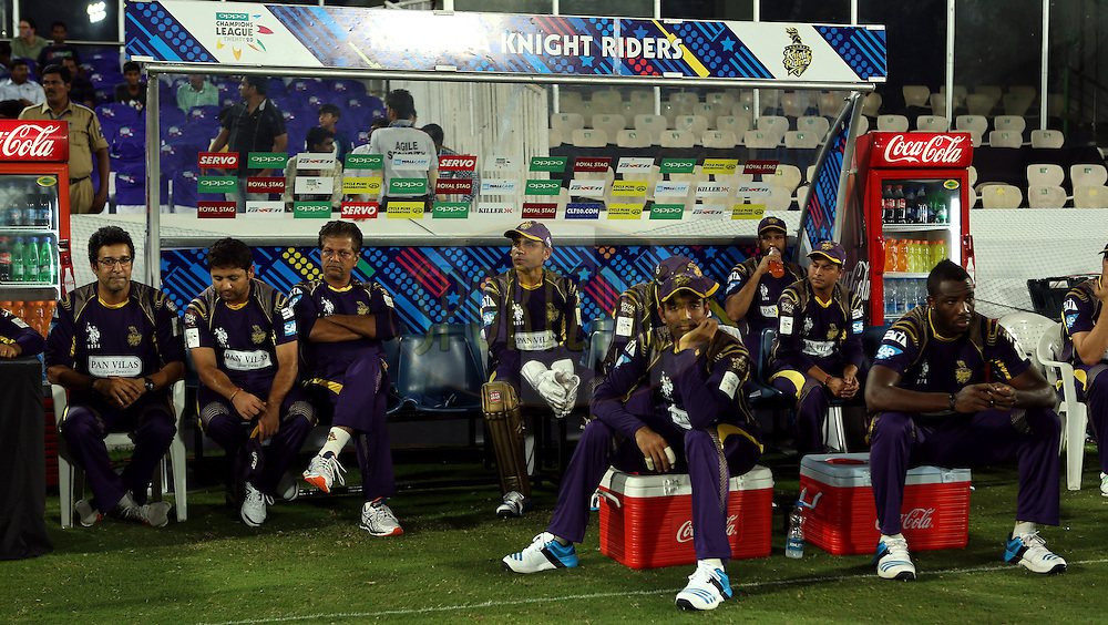 Players of Kolkatta Knight Ridersin dugout during match 7 of the Oppo Champions League Twenty20 between the Kolkata Knight Riders and the Lahore Lions held at the Rajiv Gandhi Cricket Stadium, Hyderabad, India on the 21st September 2014<br /> <br /> Photo by:  Sandeep Shetty / Sportzpics/ CLT20<br /> <br /> <br /> Image use is subject to the terms and conditions as laid out by the BCCI/ CLT20.  The terms and conditions can be downloaded here:<br /> <br /> http://sportzpics.photoshelter.com/gallery/CLT20-Image-Terms-and-Conditions-2014/G0000IfNJn535VPU/C0000QhhKadWcjYs