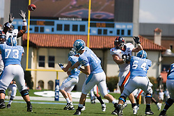 Virginia linebacker Denzel Burrell (45) disrupts a pass from North Carolina quarterback T.J. Yates (13)..The North Carolina Tar Heels football team faced the Virginia Cavaliers at Kenan Memorial Stadium in Chapel Hill, NC on September 15, 2007.  UVA defeated UNC 22-20.