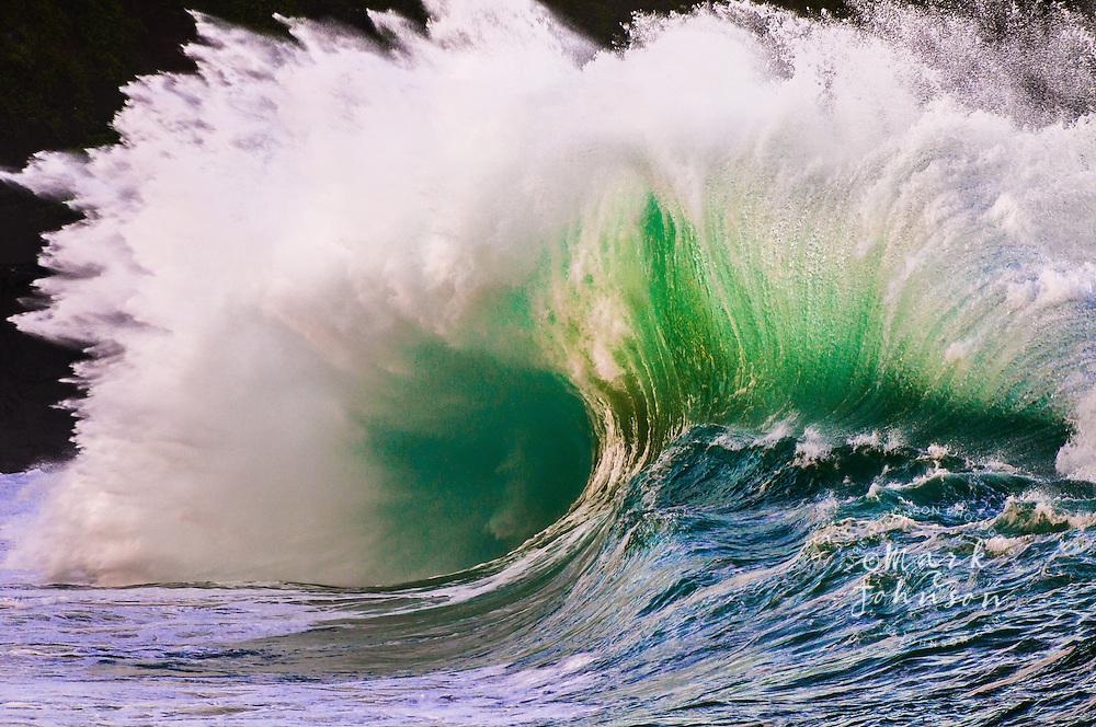 Giant wave breaking at the Waimea Bay Shorebreak, North Shore, Oahu, Hawaii