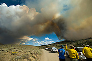 PRICE CHAMBERS / NEWS&amp;GUIDE<br /> The Red Rock fire in the Gros Ventre sends a plume of smoke skyward as wind pushes it through heavy timber east of Crystal Creek on Monday. The fire on the Bridger-Teton National Forest approximately 26-miles northeast of Jackson and has burned 2,835 acres as of Tuesday afternoon. The fire is predicted to continue moving eastward into Alkali basin as firefighters consider lighting a backfire along the Gros Ventre road to remove fuels between the fire and the road in an effort to keep the blaze where managers want it to be.