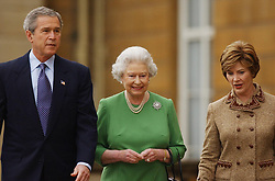US President George Bush and his wife, Laura (right), walk with Britain's Queen Elizabeth II, as they leave Buckingham Palace to travel to the Sedgefield constituency of British Prime Minister Tony Blair. The President and his wife are on the last day of their three-day state visit to the UK.