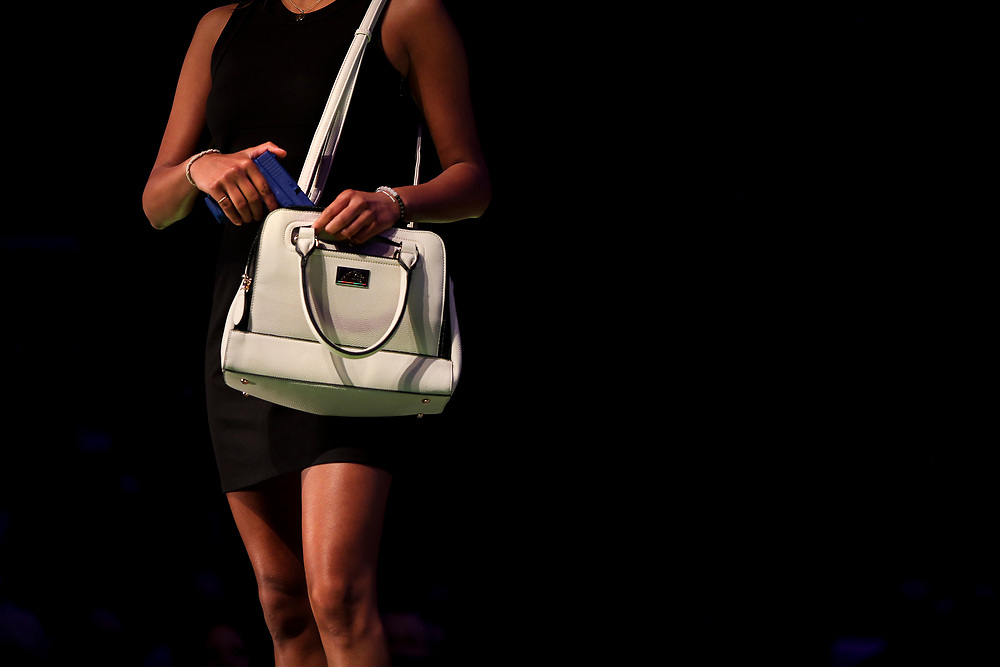 A model displays a concealed carry purse during the National Rifle Association (NRA) Carry Guard Expo Fashion Show in Milwaukee, Wisconsin, U.S., August 25, 2017.   REUTERS/Ben Brewer