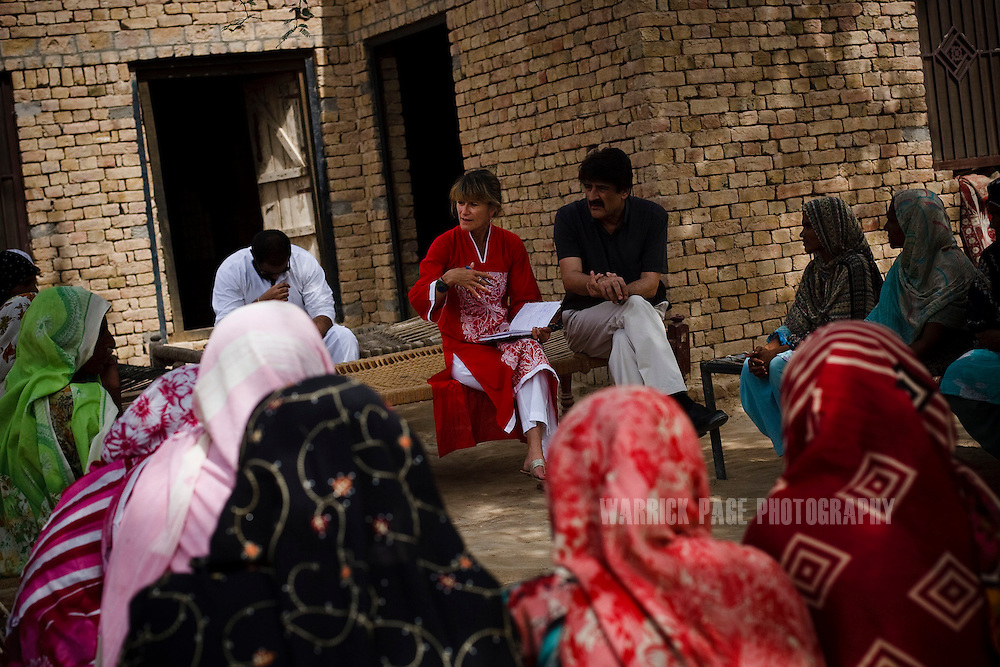 BAHAWALPUR, PAKISTAN - JUNE 18: Jacqueline Novogratz, CEO of Acumen Fund speaks with female beneficiaries at a looming site, on June 18, in Moosa Colony, Bahawalpur, Pakistan. (Photo by Warrick Page)