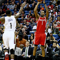 Jan 25, 2016; New Orleans, LA, USA; Houston Rockets forward Trevor Ariza (1) shoots over New Orleans Pelicans guard Tyreke Evans (1) during the first quarter of a game at the Smoothie King Center. Mandatory Credit: Derick E. Hingle-USA TODAY Sports