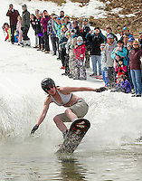 Hayley Craig daringly sports a bikini as she crosses the icy pond at Gunstock's Bring Your Own Dry Clothes race to finish off Gunstock's 2013 season.  (Karen Bobotas/for the Laconia Daily Sun)