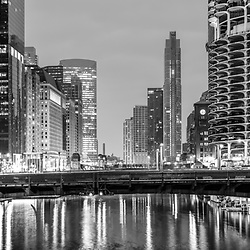 Downtown Chicago River at night black and white panorama photo with State Street Bridge (Bataan-Corregidor Memorial Bridge) and Marina City towers. Photo is ultra high resolution. Copyright ⓒ 2019 Paul Velgos with All Rights Reserved.
