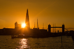 © Licensed to London News Pictures. 31/03/2016. London, UK. Warm golden sunset behind the London Shard and Tower Bridge this evening after sunny spring weather in London today. Photo credit : Vickie Flores/LNP