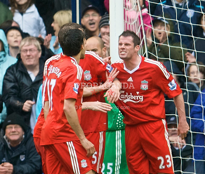 WEST BROMWICH, ENGLAND - Sunday, May 17, 2009: Liverpool's Xabi Alonso is forced to intervene, as Jamie Carragher clashes with team-mate Alvaro Arbeloa during the Premiership match West Bromwich Albion at the Hawthorns. (Photo by David Rawcliffe/Propaganda)