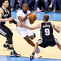 06 May 2016: Oklahoma City Thunder guard Dion Waiters (3) drives past San Antonio Spurs guard Danny Green (14) and San Antonio Spurs guard Tony Parker (9) during the San Antonio Spurs 100-96 victory over the Oklahoma City Thunder, during Game Three of the Western Conference Semifinals of the NBA Playoffs at the Chesapeake Energy Arena, Oklahoma City, Oklahoma, USA.
