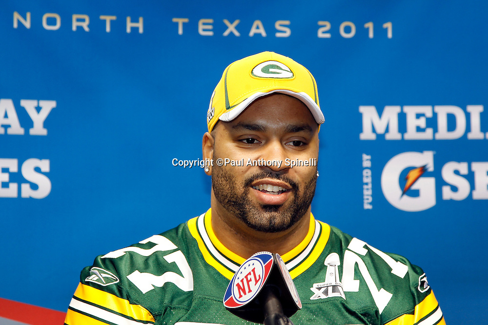 Green Bay Packers defensive end Cullen Jenkins (77) speaks to the press at Super Bowl XLV media day prior to NFL Super Bowl XLV against the Pittsburgh Steelers. Media day was held on Tuesday, February 1, 2011 in Arlington, Texas. ©Paul Anthony Spinelli