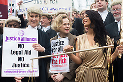 © Licensed to London News Pictures. 07/03/2014. Westminster, London, UK. Maxine Peake (centre) joins Save UK Justice campaigners in protest against government-proposed legal aid cuts at a demo on Old Palace Yard. Photo credit : David Tett/LNP