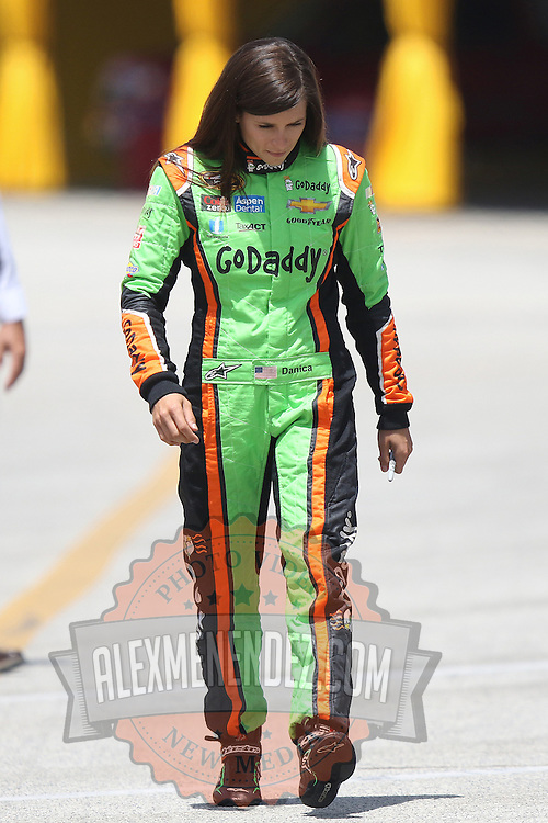 Sprint Cup Series driver Danica Patrick (10) walks down pit lane during the 57th Annual NASCAR Coke Zero 400 race first practice session at Daytona International Speedway on Friday, July 3, 2015 in Daytona Beach, Florida.  (AP Photo/Alex Menendez)