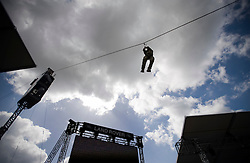 © licensed to London News Pictures. 10/05/2011. Windsor, UK.  Royal Marine Commando's using a zip rope during Rehearsals for The Royal Tattoo at Windsor Castle today (09/05/2011) which opens for its first Show tomorrow, Thursday 12th May. For the very first time, 250 French Troops from the French Army, Navy, Air Force and Gendarmerie will be performing at The Tattoo alongside the very best of the British Military. Please see special instructions for usage rates. Photo credit should read Ben Cawthra/LNP