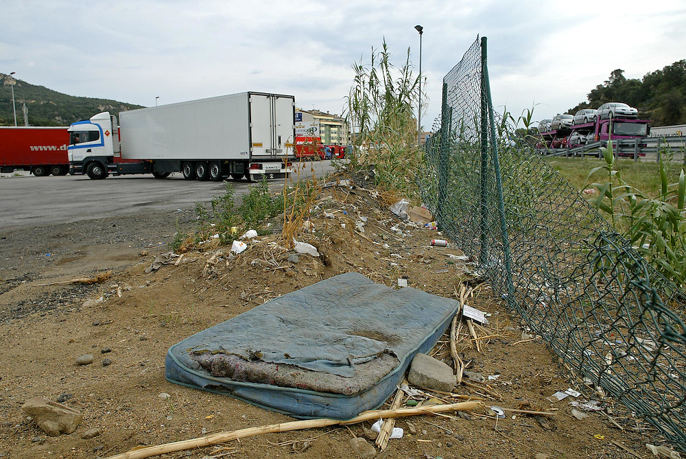 Amount of accumulated garbage in parkings for trucks near the border of Spain with France. La Jonquera (Catalonia).