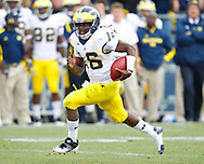 WEST LAFAYETTE, IN - OCTOBER 06: Quarterback Denard Robinson #16 of the Michigan Wolverines runs the ball against the Purdue Boilermakers at Ross-Ade Stadium on October 6, 2012 in West Lafayette, Indiana. (Photo by Michael Hickey/Getty Images) *** Local Caption *** Denard Robinson