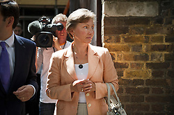 © London News Pictures. 22/07/2014. London, UK. MARINA LITVINENKO leaving a press conference in London following the British Governments announcement that a public inquiry will be held in to , the death of her husband, former Russian spy, Alexander Litvinenko. The ex-KGB officer was poisoned by a cup of tea laced with the deadly radioactive element polonium 210 during a meeting at a London hotel in 2006. Photo credit : Ben Cawthra/LNP