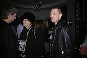 Jefferson Hack, Anita Pallenberg and dan Macmillan. DAZED AND CONFUSED GAP RED PARTY, Groucho Club, Dean st. London. 15 March 2006. ONE TIME USE ONLY - DO NOT ARCHIVE  © Copyright Photograph by Dafydd Jones 66 Stockwell Park Rd. London SW9 0DA Tel 020 7733 0108 www.dafjones.com