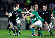 All Black Cory Jane fends off Irish Halfback Tomas O'Leary during the New Zealand All Blacks v Ireland rugby Internatioanl Test at Yarrow Stadium in New Plymouth, New Zealand. Saturday 12 June 2010.