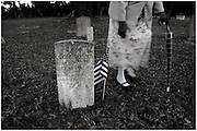 Eighty two-year-old Evelyn Greer walks past the head stone of her cousin Lee Basiden at Gould Cemetery Monday, June 21, 2010 in Harris Neck, Ga. Greer has her mother, two brother, a sister host of uncles aunts and cousins buried in Harris Neck's cemetery. (Stephen Morton for The New York Times)