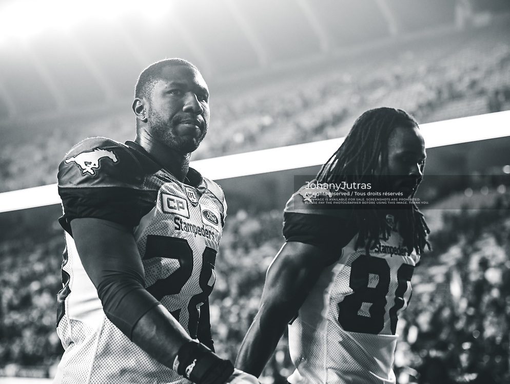 Brandon Smith (28) and Marken Michel (80) of the Calgary Stampeders after the game against the Edmonton Eskimos at Commonwealth Stadium in Edmonton AB, Saturday, September 9, 2017. (Photo: Johany Jutras)