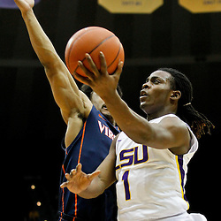 January 2, 2012; Baton Rouge, LA; LSU Tigers guard Anthony Hickey (1) shoots over Virginia Cavaliers guard Jontel Evans (1) during the first half of a game at the Pete Maravich Assembly Center.  Mandatory Credit: Derick E. Hingle-US PRESSWIRE