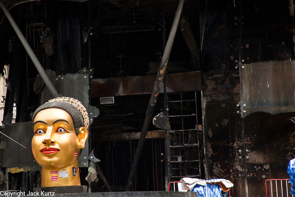 20 MAY 2010 - BANGKOK, THAILAND: An undamaged large Buddha head at Central World, the second largest shopping mall in southeast Asia. The mall was destroyed by arsonist working with the anti government Red Shirts in the Ratchaprasong Intersection in Bangkok Thursday. The day after a military crackdown killed at least six people, Thai authorities continued mopping up operations around the site of the Red Shirt rally stage and battle fires set by Red Shirt supporters in the luxury malls around the intersection. Anti government forces set fire to the mall and several other locations across Bangkok after their leaders surrendered to police.   PHOTO BY JACK KURTZ