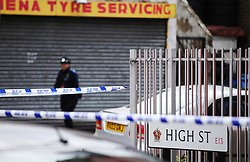 © London News Pictures. 01/11/2013. London, UK. The scene of a shooting of two shop workers at Show Supermarket in High Street, Plaistow, London. One man in his 50s is in a critical condition and the other in his 40s is in a stable condition in hospital. Photo credit: LNP