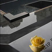 On the 15th anniversary of 9-11 at Ground Zero, yellow rose placed on the memorial plagues  by a loved ones by the name of a family member who died that day.<br /> <br /> The 2,983 names of the victims of the attacks of Sept. 11, 2001, and Feb. 26, 1993, World Trade Center truck bombing are inscribed into bronze parapets surrounding the twin memorial pools.