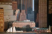 Pioneer sailboat and Lower Manhattan skyline, New York, NY