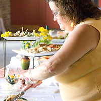 One of the Dandelion Cook Off judges makes her way down the line taking a sample of each contestant's dish.