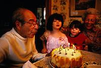 Joseph Franken blows out his 80th birthday cake