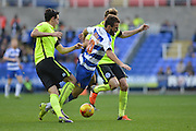 Reading's Carlos Orlando Sa is brought down during the Sky Bet Championship match between Reading and Brighton and Hove Albion at the Madejski Stadium, Reading, England on 31 October 2015. Photo by Mark Davies.