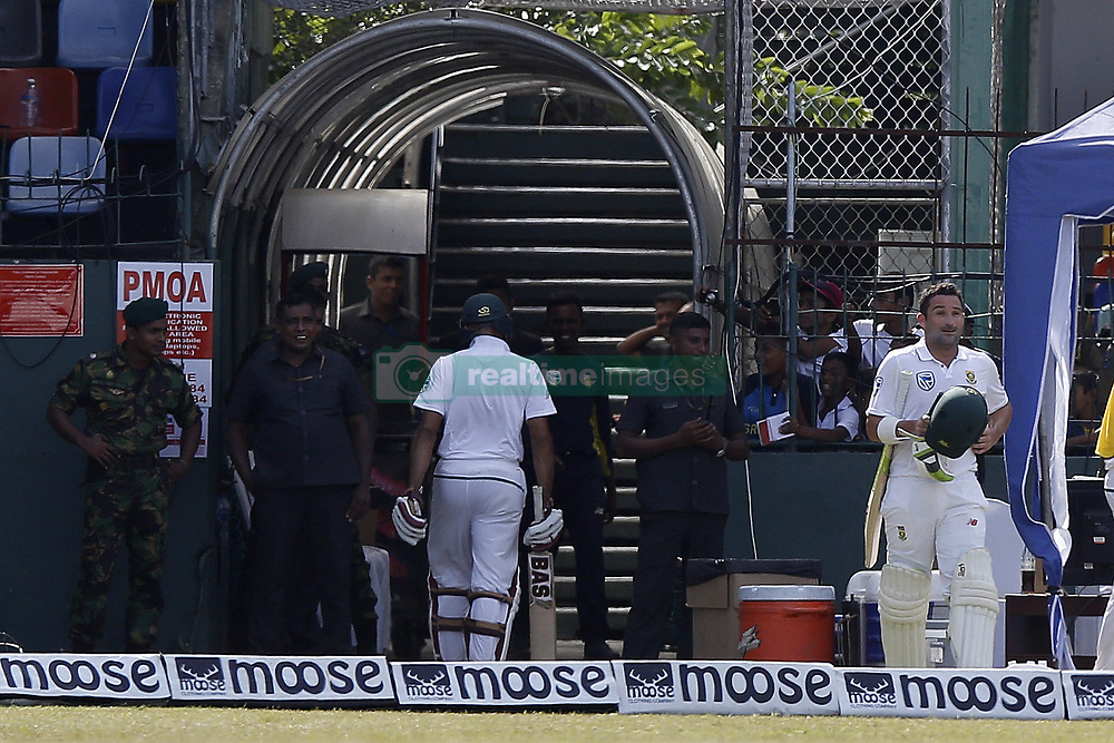 July 22, 2018 - Colombo, Sri Lanka - South African cricket team's opening batsman  Dean Elgar walks back to the ground from the dressing room following a reversing of on-field umpire decision to not-out after 3rd Umpire revealed the bowler, Sri Lankan cricketer DIlruwan Perera (unseen) had over-stepped while South African cricketer Hashim Amla smiles   during the 3rd day's play in the 2nd test cricket match between Sri Lanka and South Africa at SSC International Cricket ground, Colombo, Sri Lanka on Sunday  22 July 2018  (Credit Image: © Tharaka Basnayaka/NurPhoto via ZUMA Press)