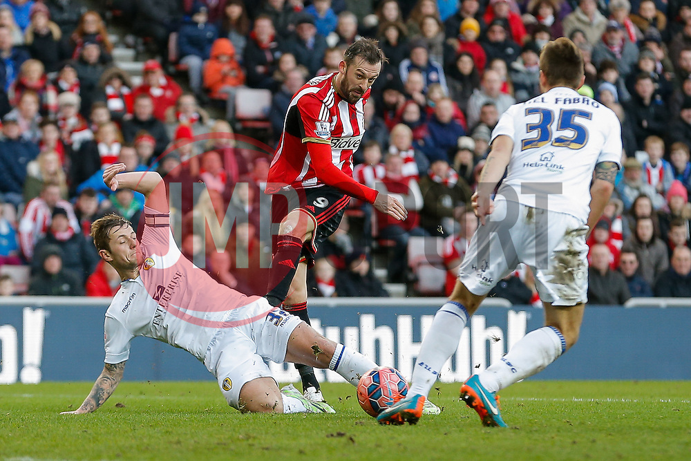 A shot from Steven Fletcher of Sunderland is deflected by Liam Cooper of Leeds United - Photo mandatory by-line: Rogan Thomson/JMP - 07966 386802 - 04/01/2015 - SPORT - FOOTBALL - Sunderland, England - Stadium of Light - Sunderland v Leeds United - FA Cup Third Round Proper.