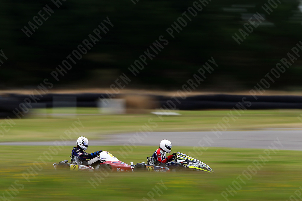 Lochlan Miller, 2, and Mason Armstrong, 63, race in the Rotax Light class during the 2012 Superkart National Champs and Grand Prix at Manfeild in Feilding, New Zealand on Saturday, 7 January 2011. Credit: Hagen Hopkins.