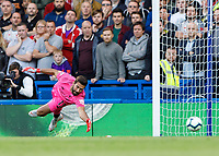 Football - 2018 / 2019 Premier League - Chelsea vs. Liverpool<br /> <br /> Alisson Becker (Liverpool FC) is beaten by the low drive of Eden Hazard (Chelsea FC)  as Chelsea take the lead at Stamford Bridge <br /> <br /> COLORSPORT/DANIEL BEARHAM