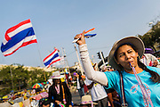 "29 DECEMBER 2013 - BANGKOK, THAILAND: An anti-government protestor near Democracy Monument in the old part of Bangkok to protest the ruling Pheu Thai party. Protest leader and former Deputy Prime Minister Suthep Thaugsuban announced an all-out drive to eradicate the ""Thaksin regime."" The anti-government protesters have vowed to continue their protests even though the government has been dissolved and new elections called for in February. The protests have been ongoing in Bangkok since November and are growing increasingly violent.             PHOTO BY JACK KURTZ"